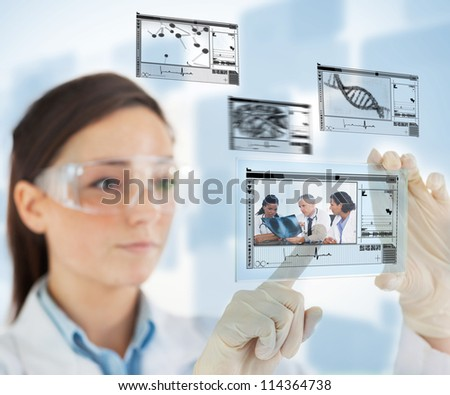 Laboratory technician selecting medical images from hologram interface