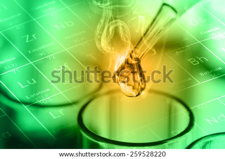 laboratory test tubes, green tone - stock photo