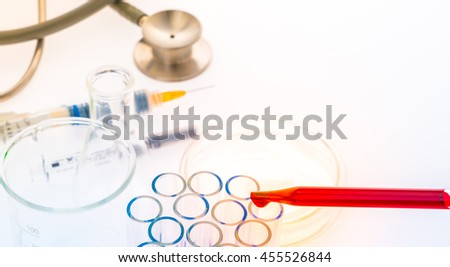 laboratory test tubes,medical glassware , Stethoscope,plastic syringe  ( Filtered image processed colorful effect. ) - stock photo
