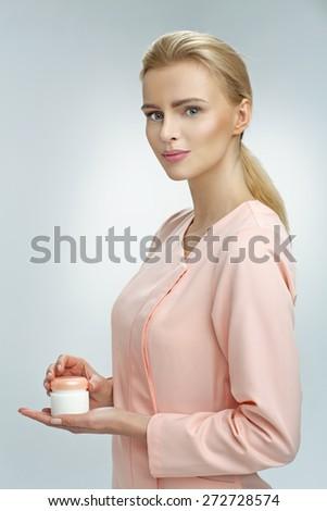 Laboratory worker presenting new cream - stock photo