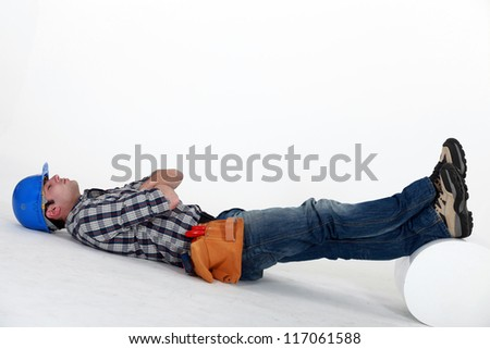 Laborer laid on the floor - stock photo