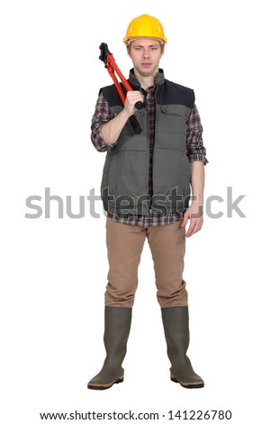 Laborer standing on white background - stock photo