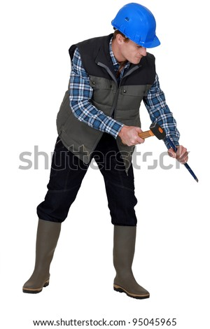 Laborer using hammer on white background - stock photo