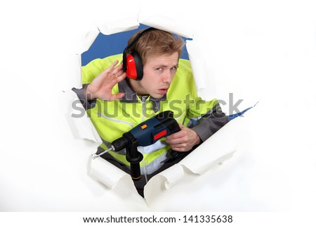 Laborer with drill - stock photo