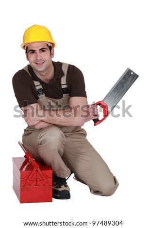 Laborer with saw and toolbox - stock photo