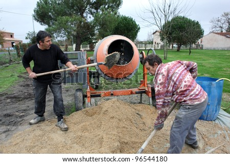 Laborers using a cement fixer - stock photo