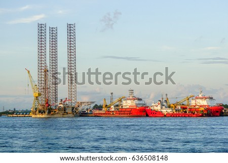 Labuan,Malaysia-June 17,2016:Multi function offshore support/platform supply vessels & Jackup oil rig platform under repair at shipyard in Labuan,Malaysia on 17th June 2016.