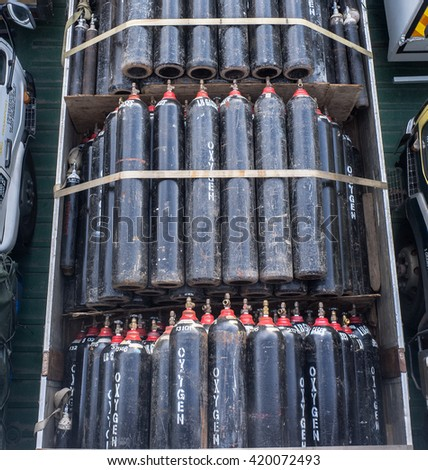 Labuan,Malaysia-Oct 24,2014:Oxygen cylinders ready for transport in the port of Labuan island, Malaysia on 24th October 2014.