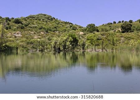 Lac de Padula (Padula lake) near the mountain village Oletta in the Nebbio region, Northern Corsica, France - stock photo