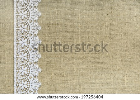 Lace border over burlap - stock photo