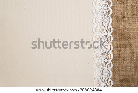 Lace border over burlap background - stock photo