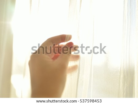 lace curtain and hand