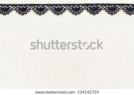 Lace flowers frame close up isolated on Fabric texture - stock photo