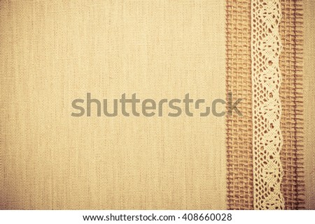Lace frame on natural linen, bright cloth fabric background. Retro vintage style