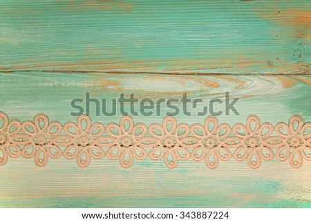 lace on painted wooden background