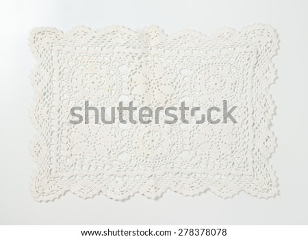 lace place mat on white background - stock photo