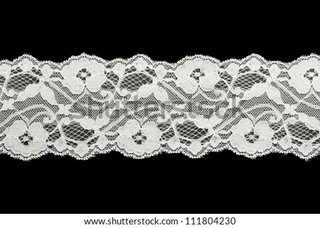 Lace trim ribbon over white. Embroidered fabric - stock photo