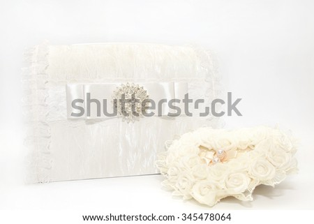 Lace wedding accessories. Wedding rings on a white satin pillow. Wedding gift box. Wedding decoration. - stock photo