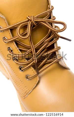 laces on the brown boots - stock photo