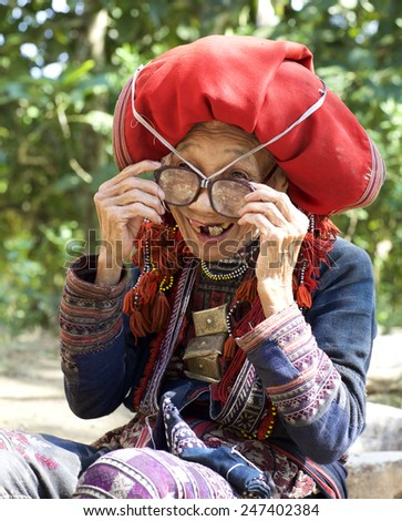 LACH MAN, VIETNAM - OCT 25: Unidentified woman from the Red Dao Ethnic Minority People on October 25, 2014  in Lac Man, Vietnam. Red Dao Minority are the 9th largest ethnic group in Vietnam - stock photo