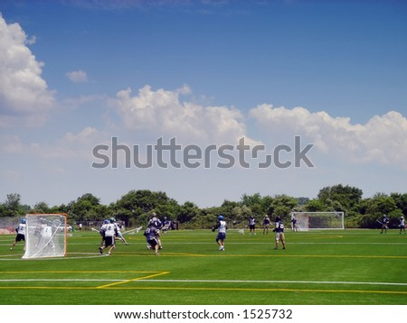 Lacrosse players in action on the Floyd Bennett field in Brooklyn, New York - stock photo