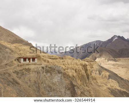 Ladakh, India - April 8, 2012: A Ladakhi house is built on the cliff of Himalayas. It has been taken on April 8, 2012 in Ladakh, India.