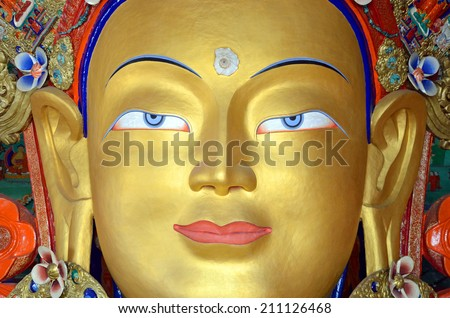 LADAKH, INDIA  AUGUST 1, 2014: Maitreya Buddha statue is a Tibetan Buddha statue that was installed in Thiksey monastery to commemorate the visit of the 14th Dalai Lama to this monastery in 1970. - stock photo
