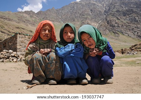 LADAKH, INDIA - AUGUST 27: Small unidentified muslim children in Ladakh Area on August 27, 2012. Education has been made free for children for 6 to 14 years of age in India.