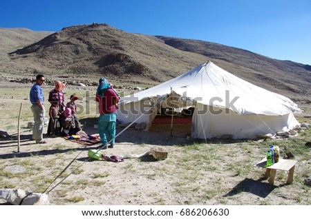 LADAKH, INDIA - July 2016 : A unidentified Indian man talks with  Changtang nomad people in the Himalayan mountains in Ladakh, India