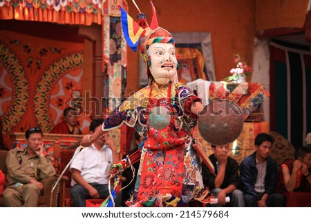 LADAKH, INDIA-JULY 29, 2012 - An unidentified buddhist monk dancing during a mask festival at Dak Thok Monastery in Ladakh, India - stock photo