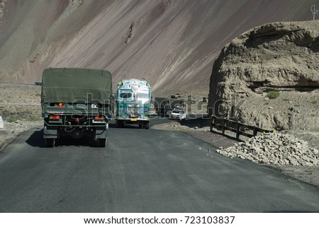LADAKH, INDIA - SEP 13, 2017 -Painted lorry on narrow road above the Indus River, Ladakh, India