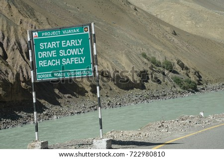 LADAKH, INDIA - SEP 13, 2017 Traffic safety sign on narrow road above Indus River in Ladakh, India
