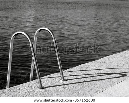 ladder by sea black and white  - stock photo