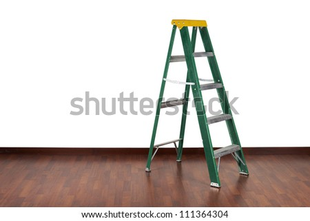 Ladder in interior wooden floor and white wall - stock photo