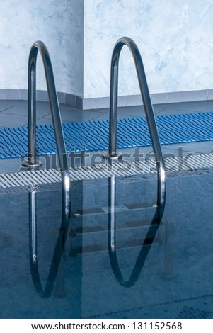 ladder in the swimming pool in spa hotel - stock photo