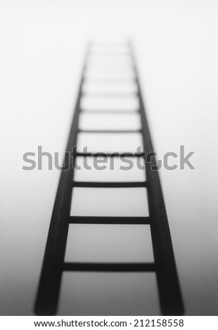 Ladder leading to light source - stock photo