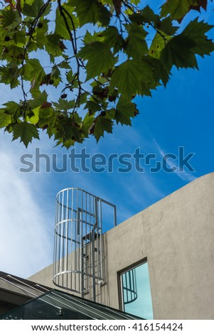 ladder leading to the rooftop of a modern building - stock photo