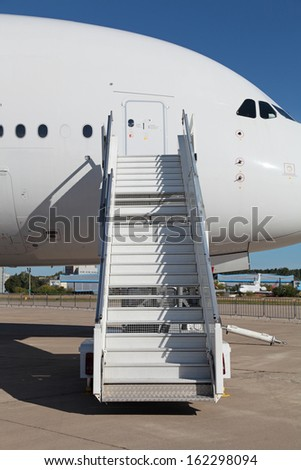 Ladder near the entrance to the  large passenger airliner, nobody