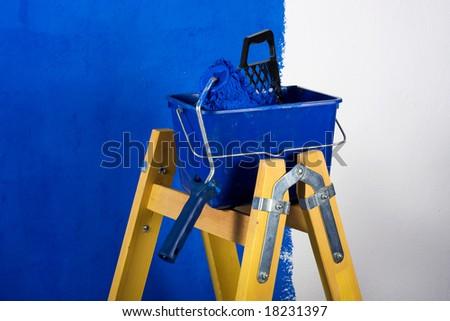Ladder, roller brush, bucket - stock photo