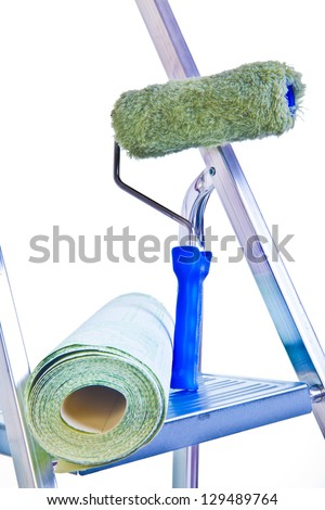 ladder wallpaper and blue brush on gray wall background - stock photo