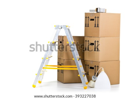Ladder with stack of moving carton boxes over white background - stock photo
