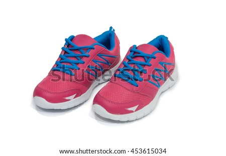 Ladies blue and pink running shoes on white background