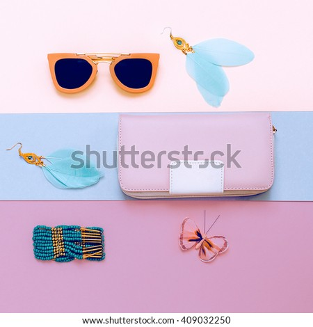 Ladies Fashion Accessories. Pink Clutch, Sunglasses and Jewelry. Pastel Colors Trend - stock photo