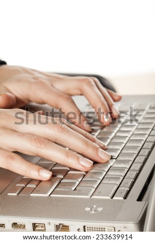 Ladies fingers to the keyboard of the laptop - stock photo