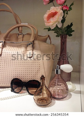 Ladies purse and perfume and sunglasses in wardrobe