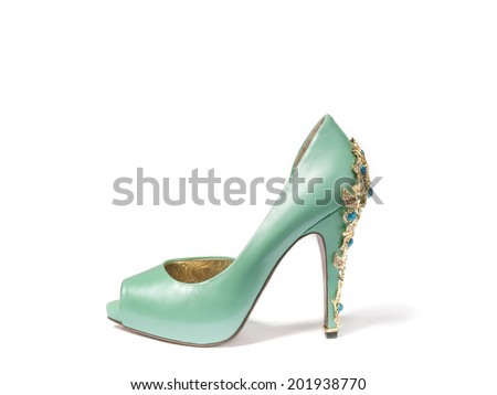 Ladies turquoise high-heeled shoes with stones on a white