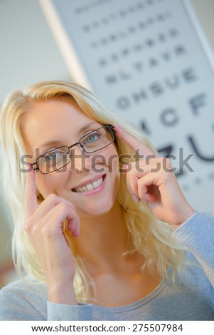 Lady at Opticians - stock photo