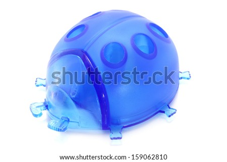 Lady bird pencil sharpener on a white background - stock photo