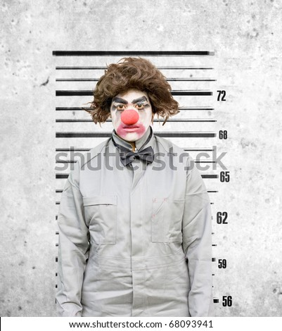 Lady Clown Has Her Identification Mug Shot Taken Against The Height Wall Down At The Police Station