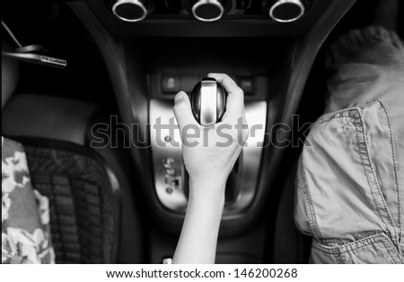 lady drive the car her hand push gearbox